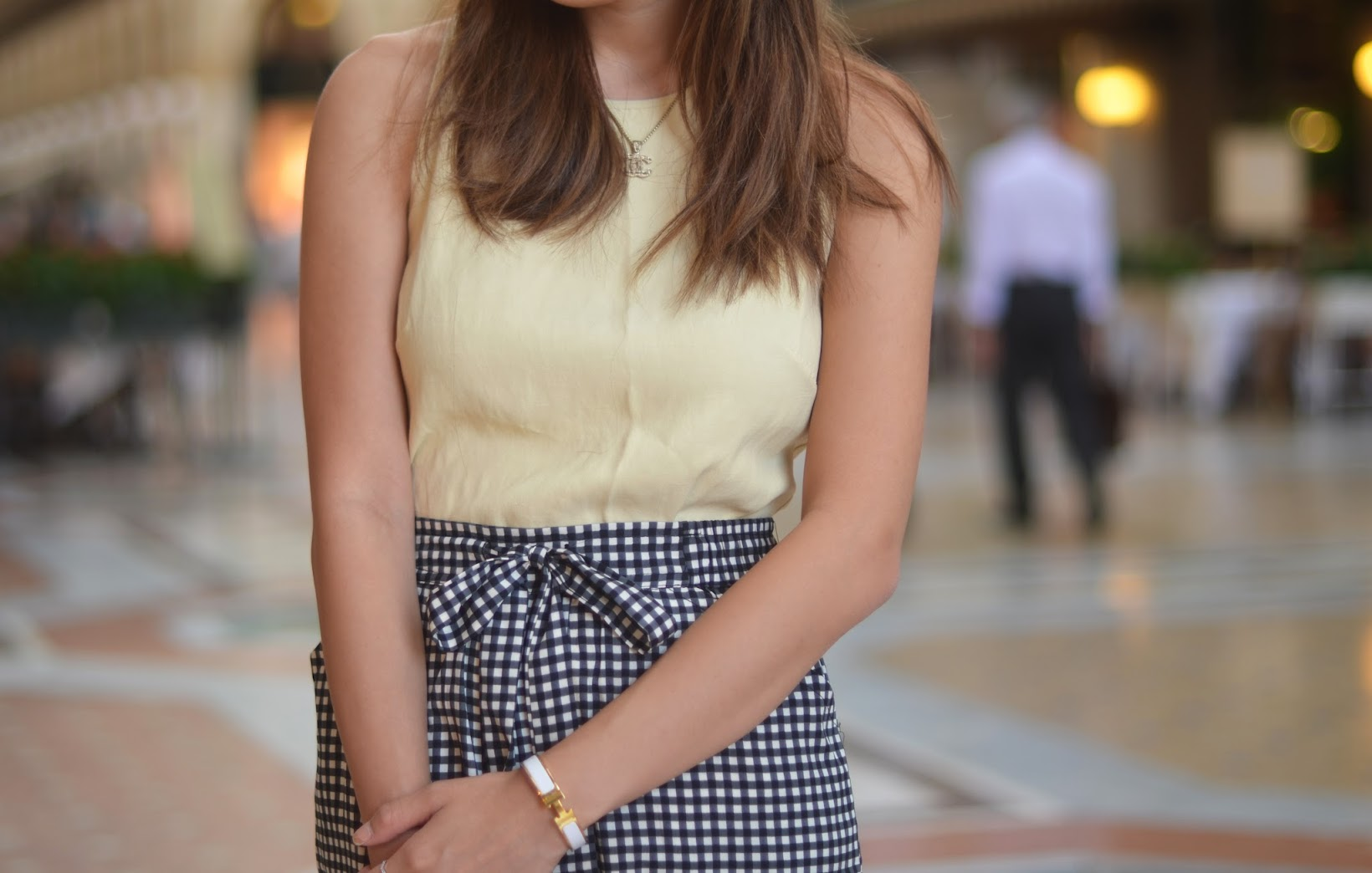 milan, outfit, gingham pants, yellow top, hermes bracelet