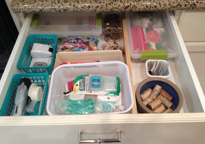 kitchen drawer holding miscellaneous things in various containers