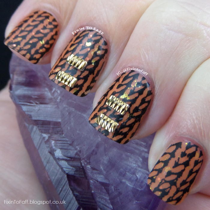 Halloween black and orange sweater jumper nail art with gold stud accents.