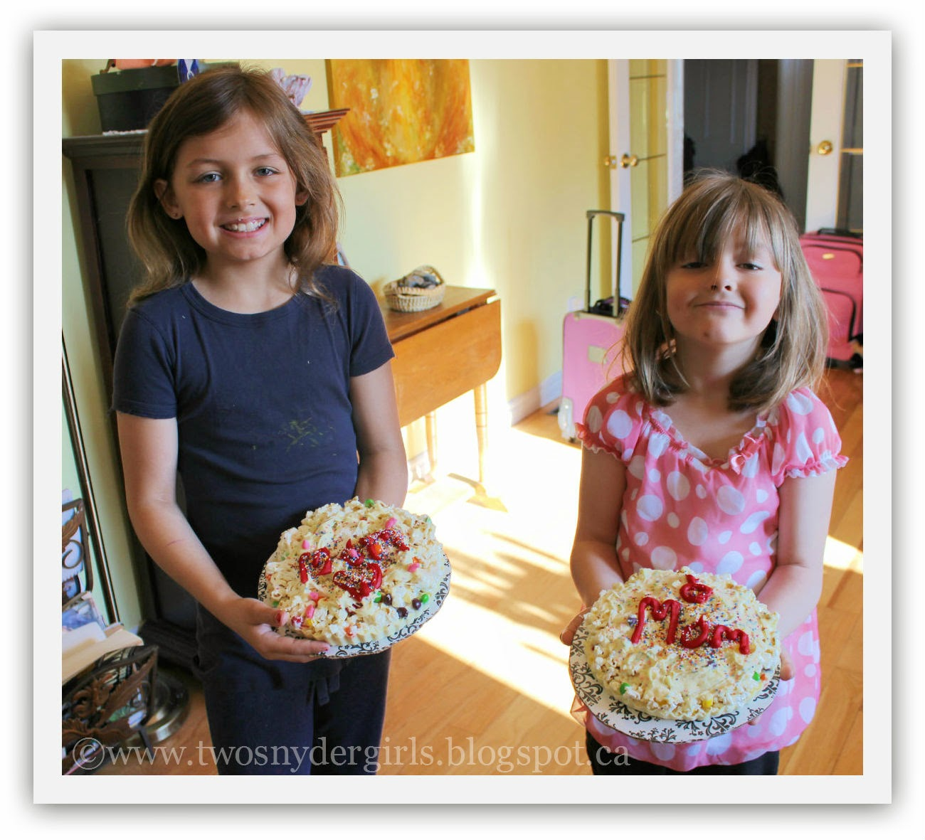 Girls holding their Popcorn Pizza with Mom written on them
