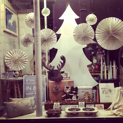 Willow and Stone Christmas window display with paper decorations