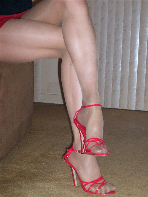 Pantyhose and strappy shoes
