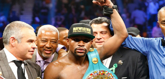 Floyd Mayweather and other people in the ring