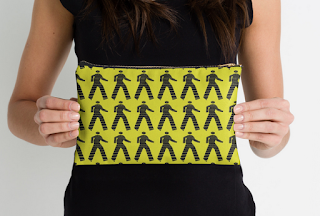 http://www.redbubble.com/people/louweasely/works/8100788-walk-man?p=pouch&ref=artist_shop_grid