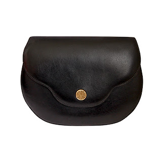 Vintage 1970's black leather Hermes convertible bag with gold front snap closure.