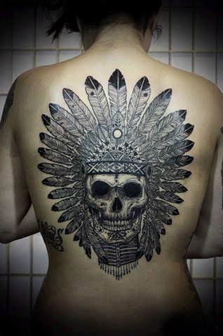 tribal skull mask tattoo on the back