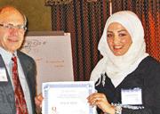 photo - Tasneem Alfalah presenting her research at 2012 QFD symposium