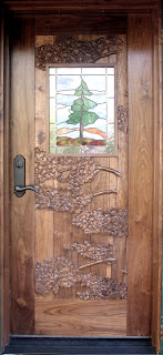 walnut door, hand carved, http://huismanconcepts.com/