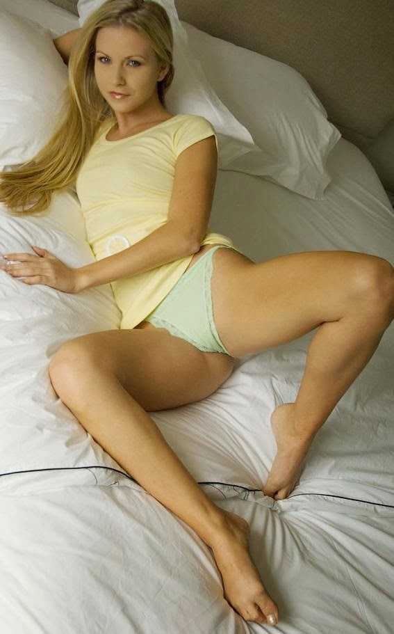 Cute blonde with her legs open