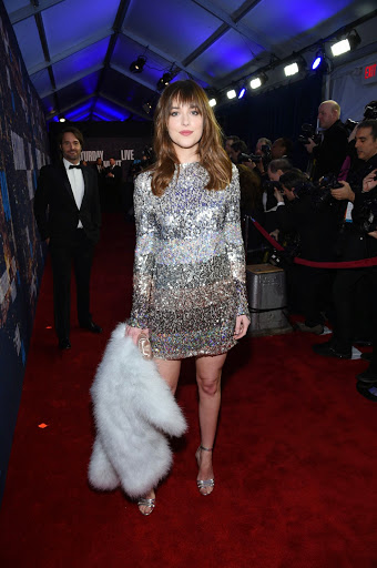 Dakota Johnson in Sonia Rykiel dress, Gianvito Rossi shoes at 2015 SNL 40th Anniversary Celebration red carpet