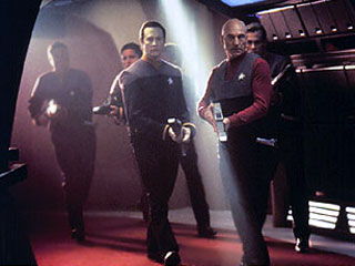 Picard searching Star Trek First Contact 1996 movieloversreviews.blogspot.com