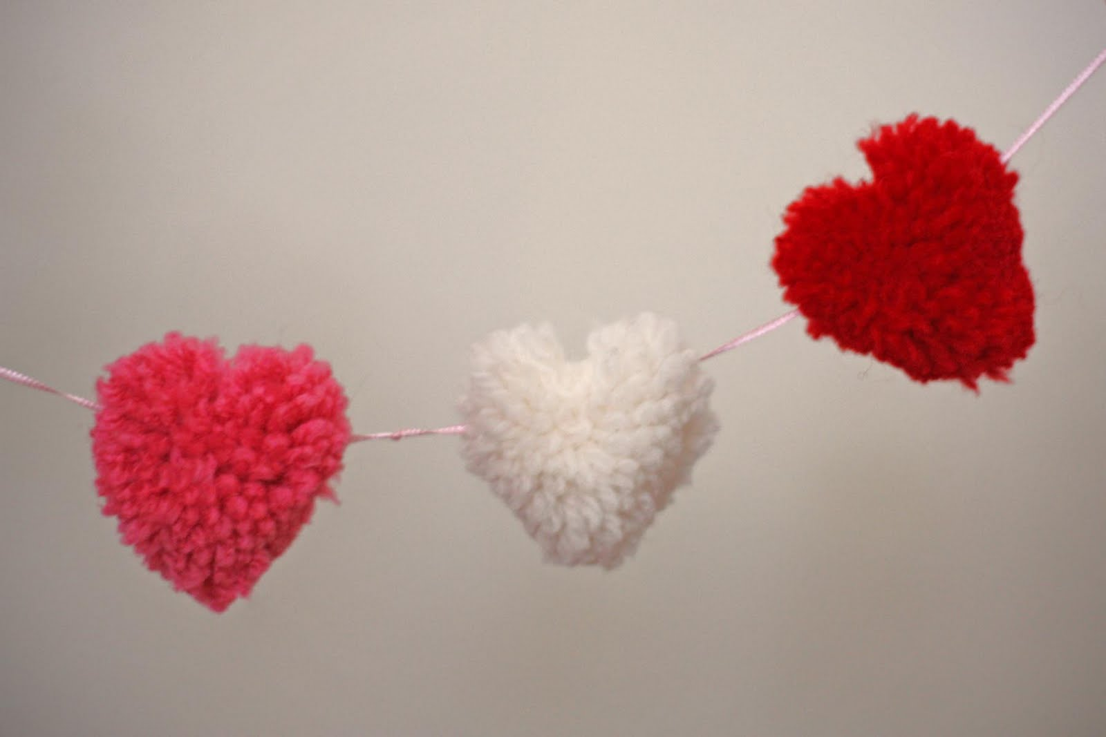 all in one days time heart shaped pom pom garland. Black Bedroom Furniture Sets. Home Design Ideas