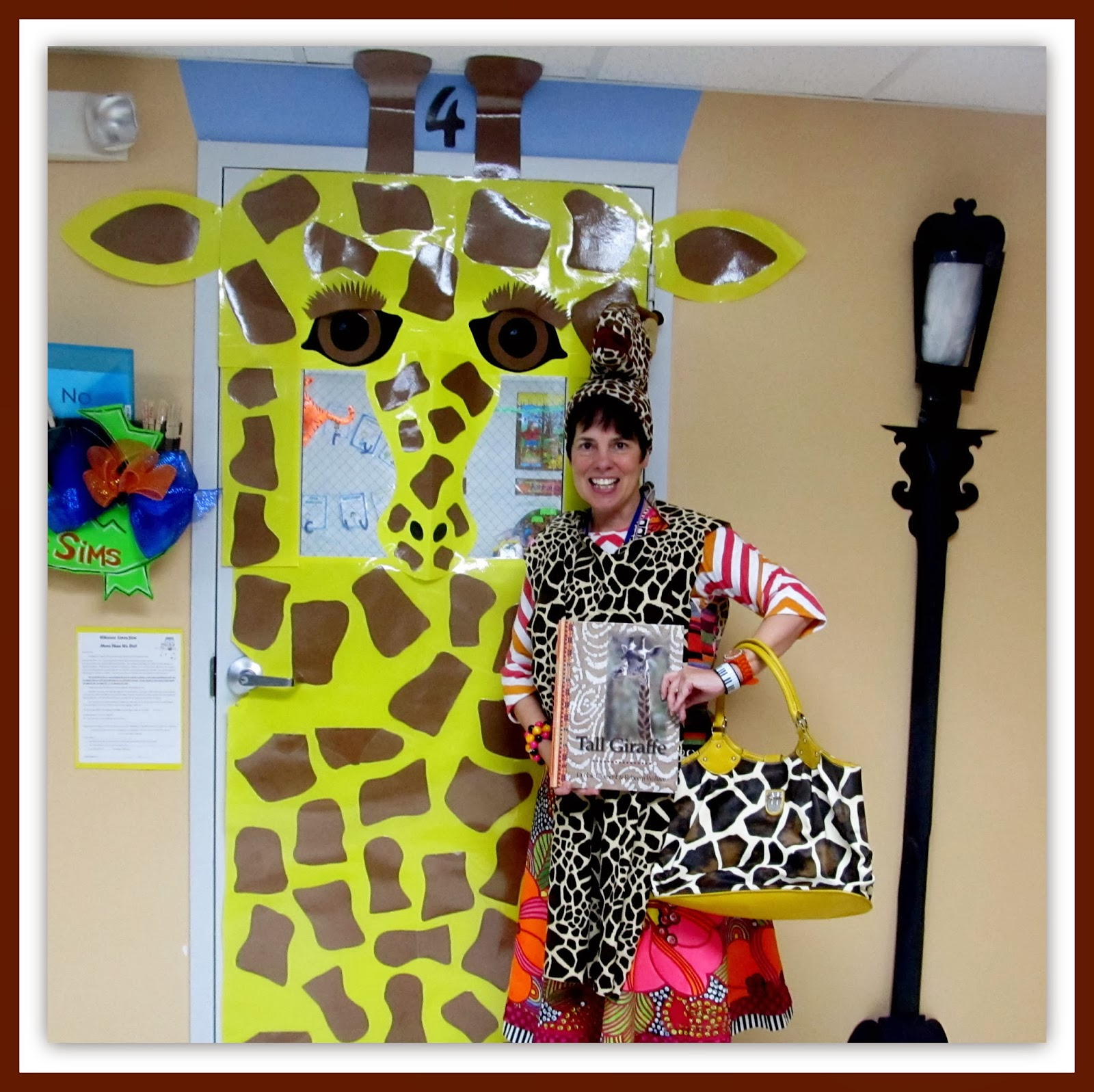 "Debbie Clement, author of ""Tall Giraffe"" with decorated classroom door"