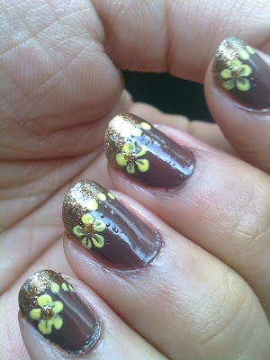 Brown nails with gold tips and yellow flowers