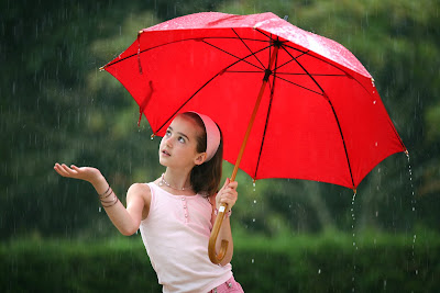 young pretty girl umbrella rain shrinking