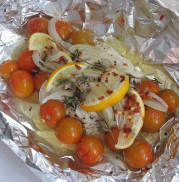 Baked flounder packets with cherry tomatoes, onion, and lemon