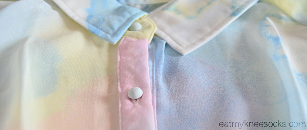 Romwe's original design features a pointed pastel collar with soft white buttons.