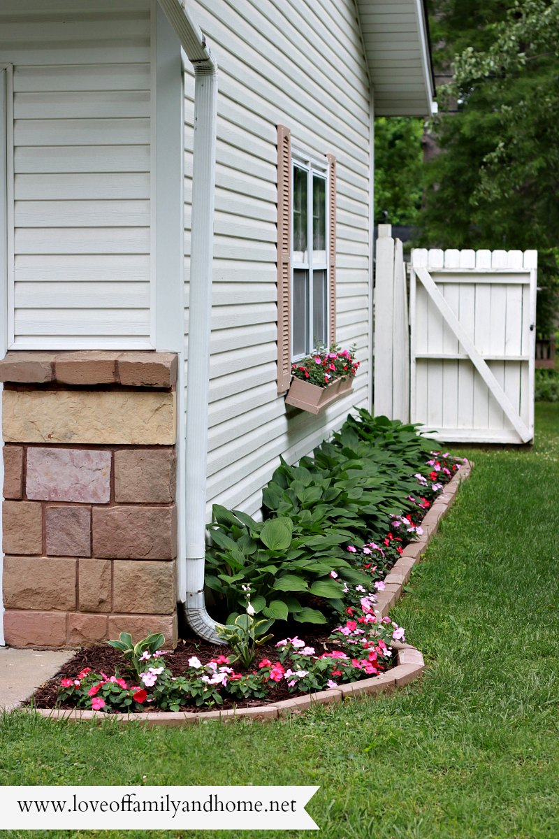 Side yard makeover creating curb appeal love of family for Side of house garden design