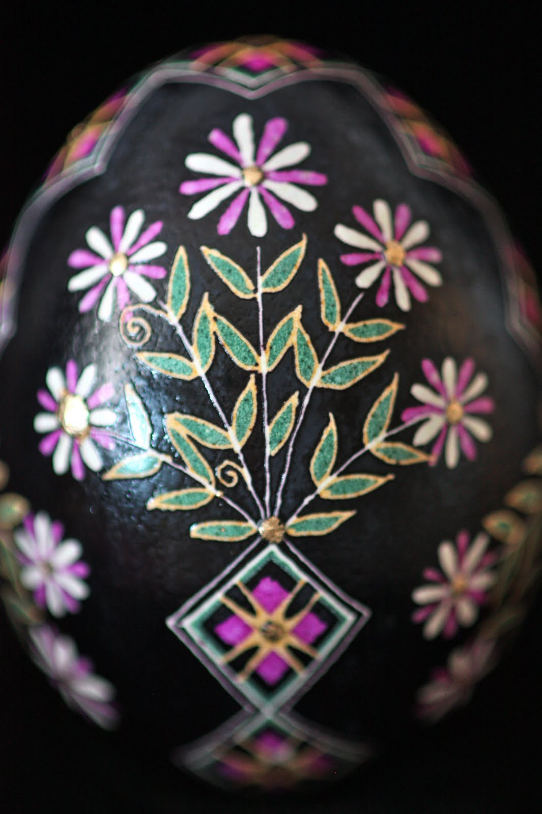 Floral Sakvy Meander Ukrainian Egg in Pink, Yellow and White on Black Background with Gold Accents