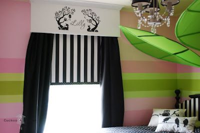 etsy vinyl wall decal, ikea chandelier and leaves, shadow cuts pillows and DIY striped headboard