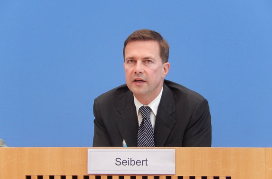 Seibert is a loyal stupid hand puppet who really reads everything, so government spokesman Seibert