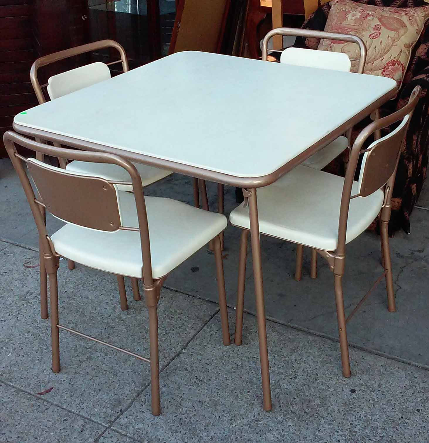 UHURU FURNITURE & COLLECTIBLES SOLD Cosco Folding Table and 4 Chair Set