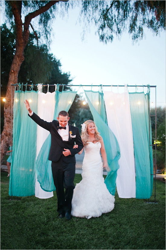 Wedding talk draped outdoor reception entrance