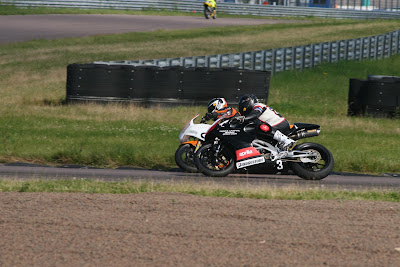a close battle between Aprilia Motorcycles at Rockingham