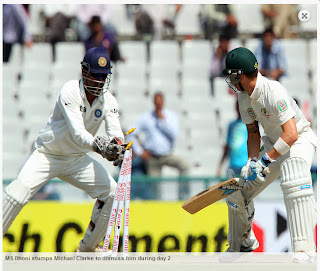 MS-Dhoni-stumps-Michael-Clarke-INDIA-v-AUSTRALIA-3rd-TEST
