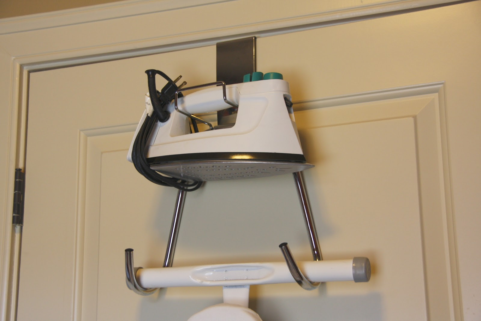 simply organized: simple solution: ironing board organizer