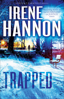 Cover of suspense novel, Trapped, by Irene Hannon. A girl is shown walking along in the cold. Trees are in the background, and a snowy scene with a lone park bench are in the foreground.