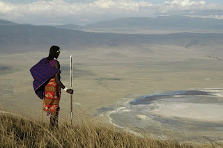 Photo of a local Maasai surveying the Ngorongoro Crater NCA in Tanzania
