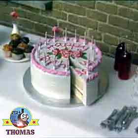 Thomas the train and the Birthday picnic party buffet food and beautiful Birthday cake with candles