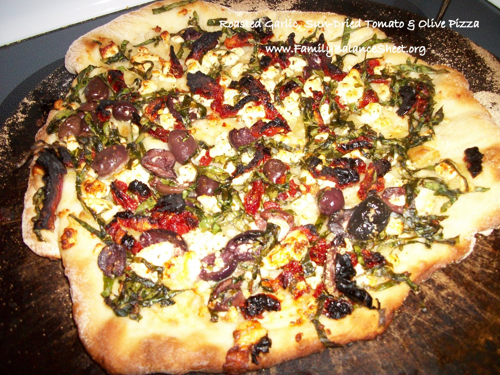 roasted garlic sun dried tomato olive pizza family balance sheet. Black Bedroom Furniture Sets. Home Design Ideas