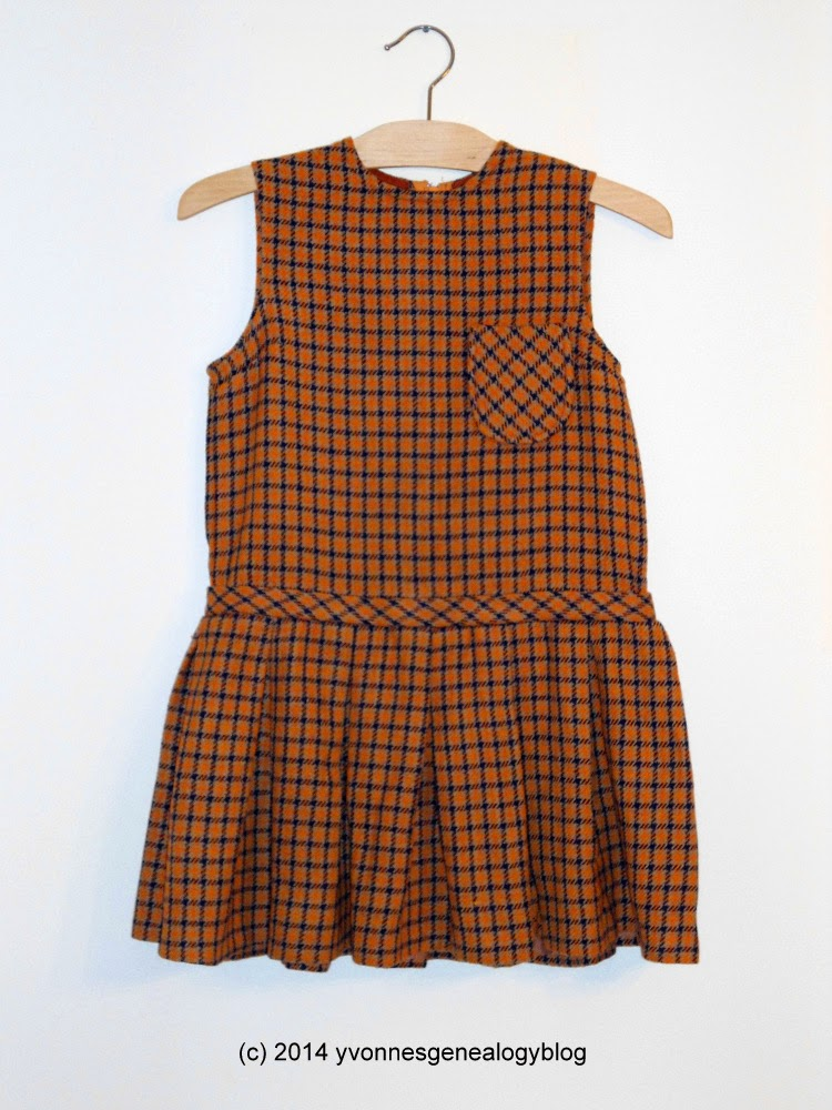 Front view of child's wool plaid-patterned dress