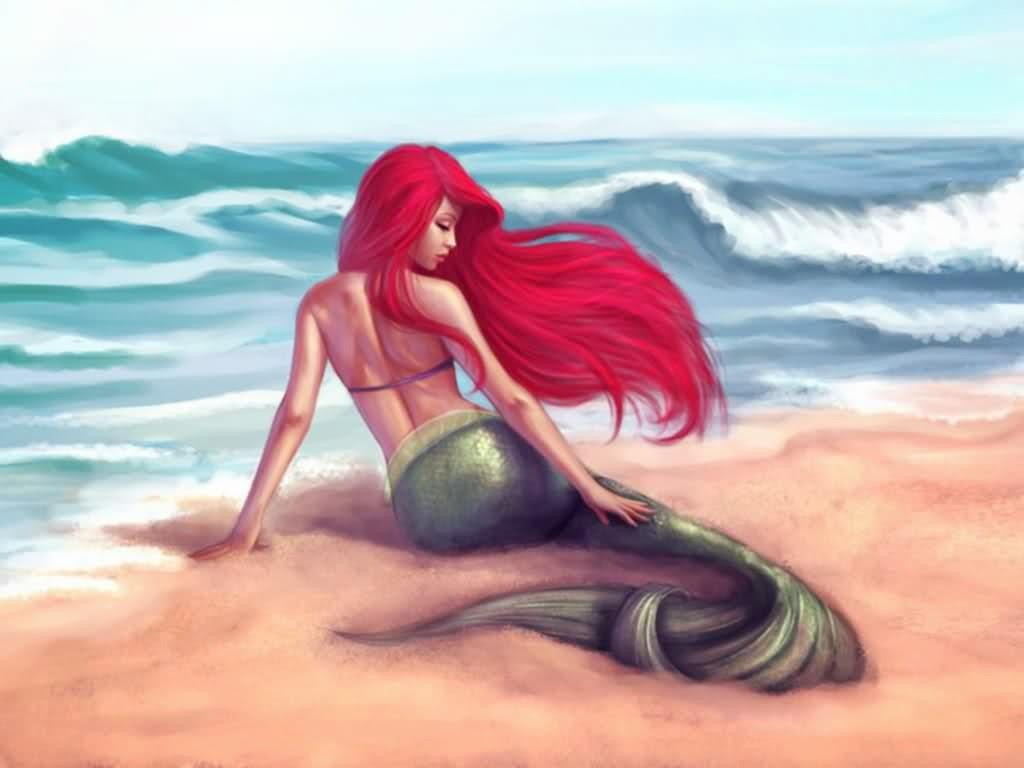 Sirena descansando en la orilla