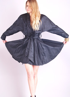Vintage 1980's black leather cape coat mini dress with belted tie front closure.
