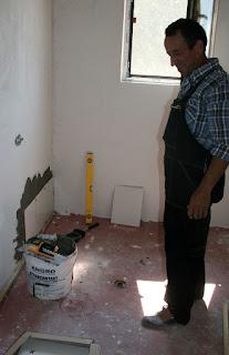 Finally tiles go on the wall