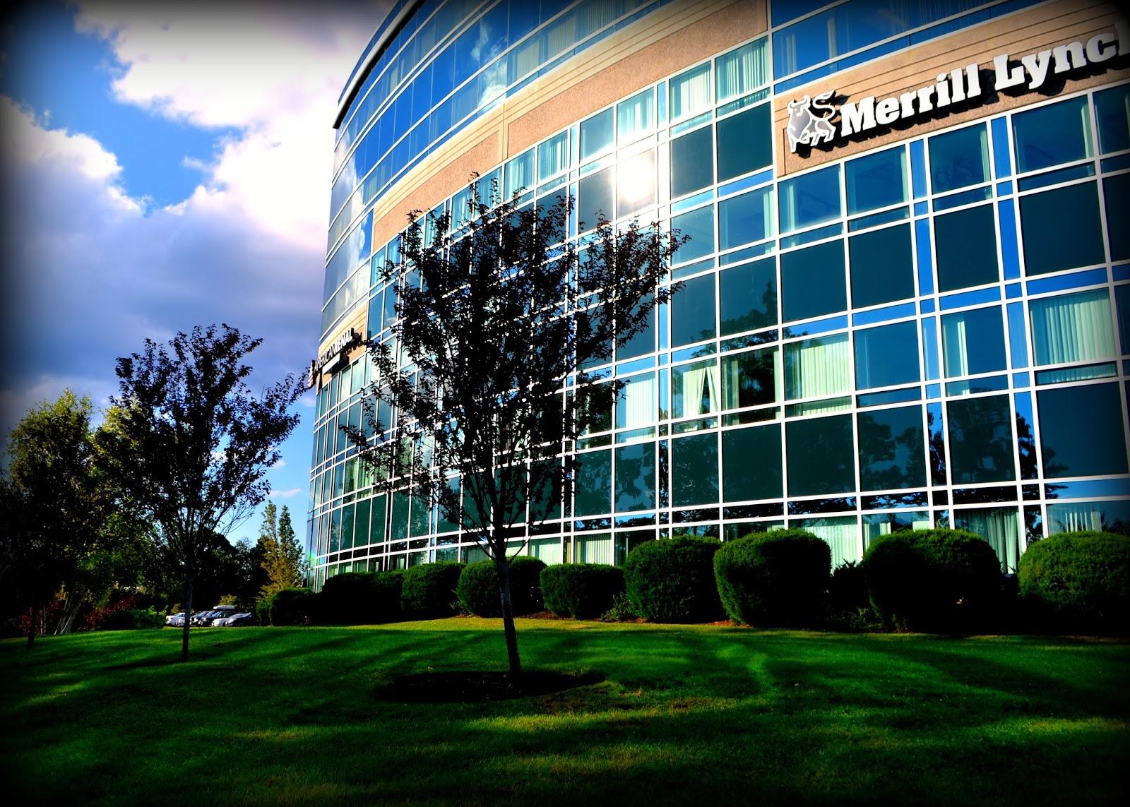 cummings center, reflections, grass, clouds, shadows