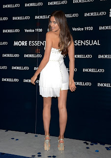 Irina Shayk reveals her amazing legs in a short white dress