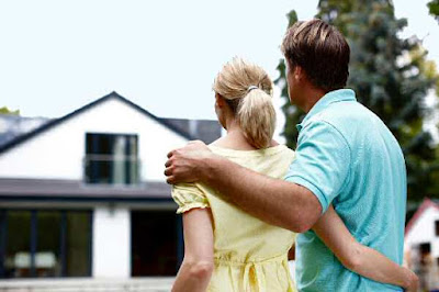 Young couple buying a home looking buy purchase