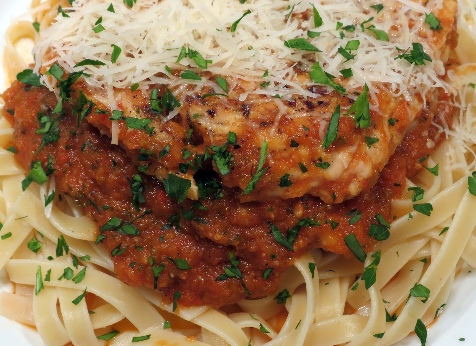 Dinner with the Welches: Parmesan Chicken over Spicy ...