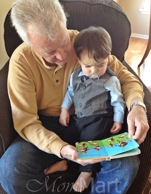 Grandpa reading to his grandson