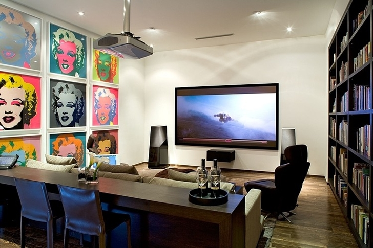 Home theater in Small minimalist home by Steven Kent