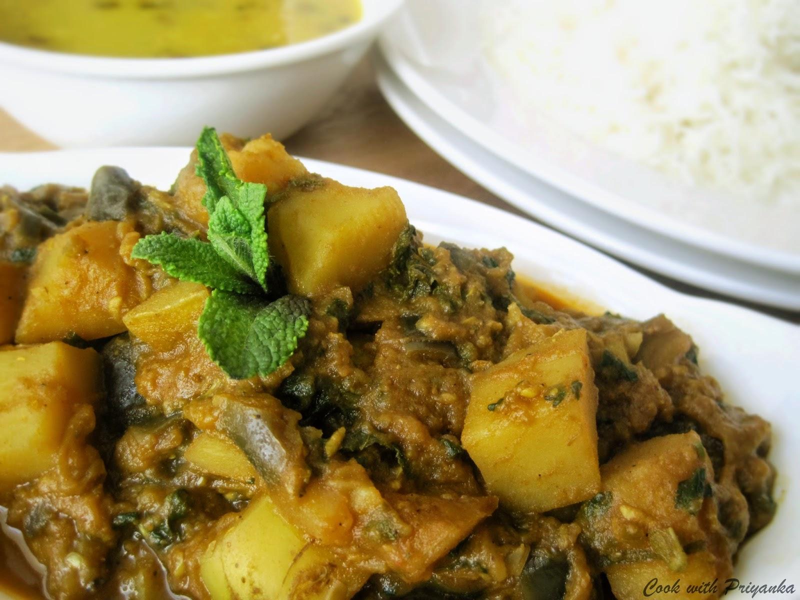 http://cookwithpriyankavarma.blogspot.co.uk/2014/04/mommys-lehsuni-aloo-baigan-aubergines.html