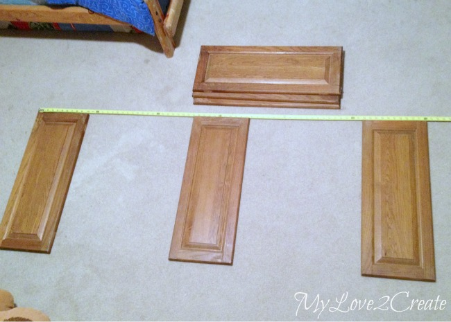 Laying out the cabinet doors to measure how big to make the desk