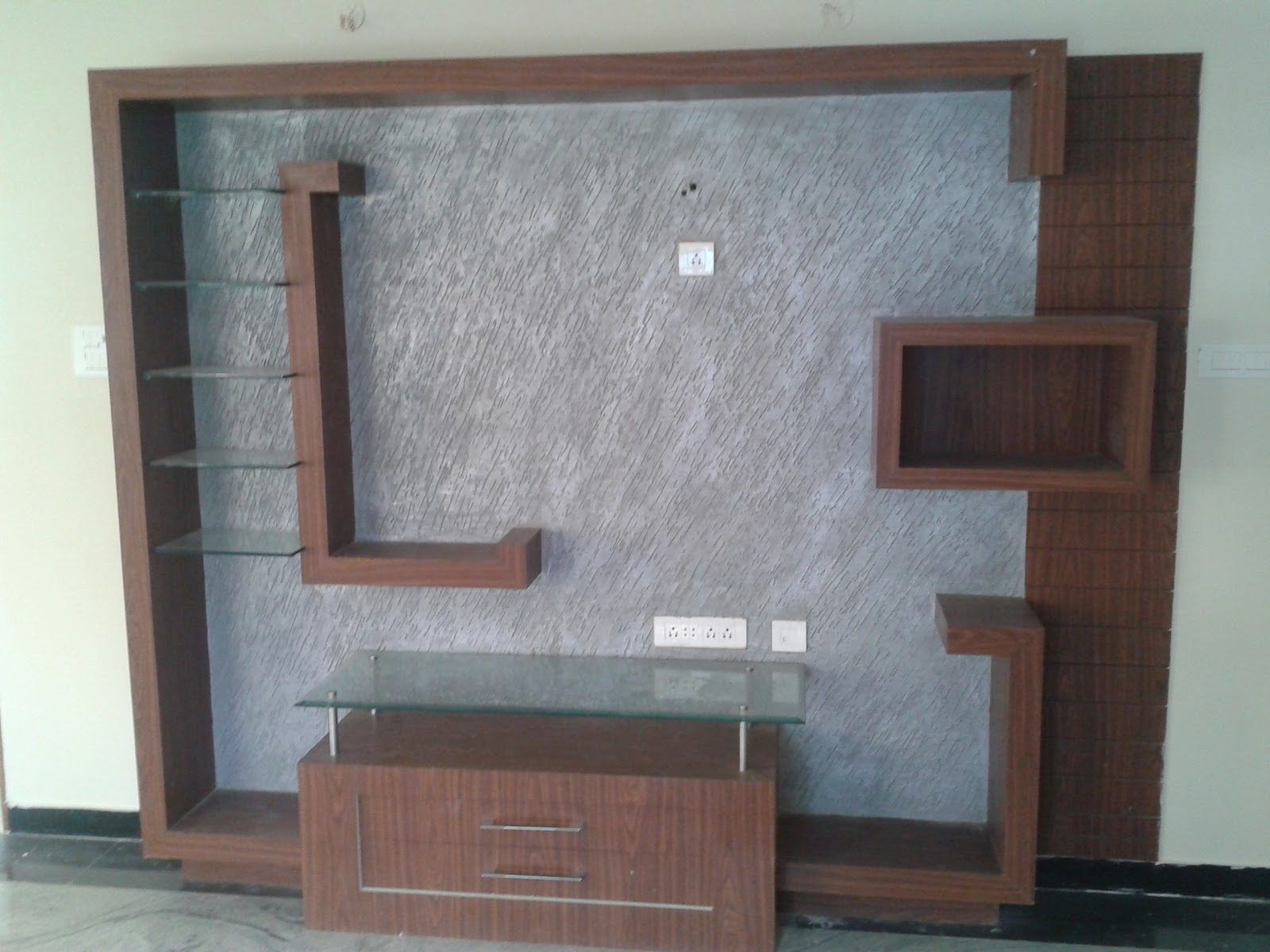 Living room lcd unit design living room interior designs for Latest lcd wall unit designs