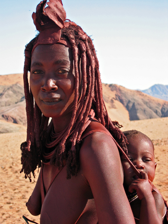 Safari Fusion blog | African Marsala | Beautiful Himba women with her baby, Kaokoveld, Namibia | Photographer © Kellie Shearwood