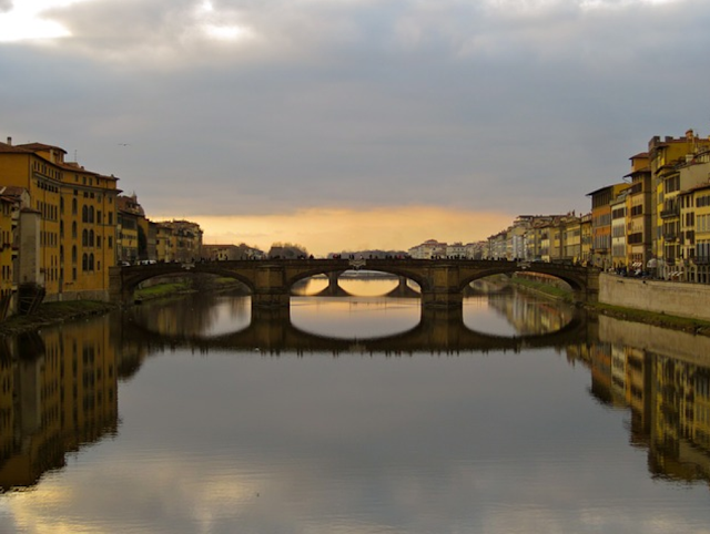 a beautiful view of arno river and bridge