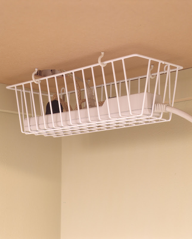 Use screw hooks to hang a basket under your desk to keep cords hidden ...